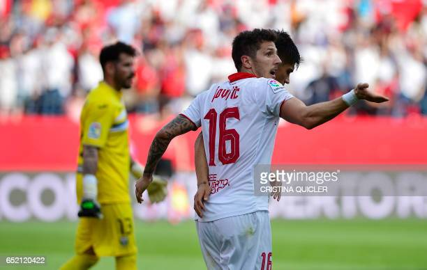 Sevilla's Montenegrin forward Stevan Jovetic celebrates after scoring during the Spanish league football match Sevilla FC vs Club Deportivo Leganes...