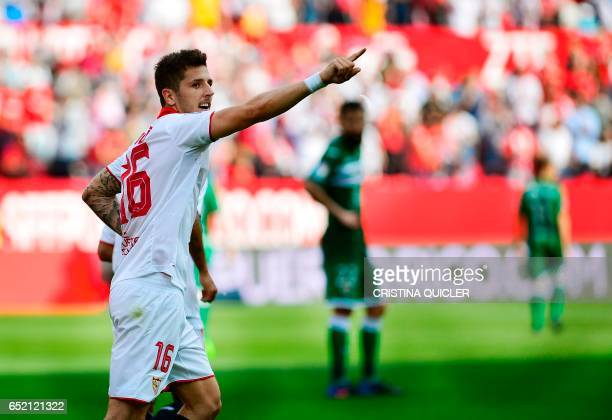 CORRECTION Sevilla's Montenegrin forward Stevan Jovetic celebrates after scoring during the Spanish league football match Sevilla FC vs Club...