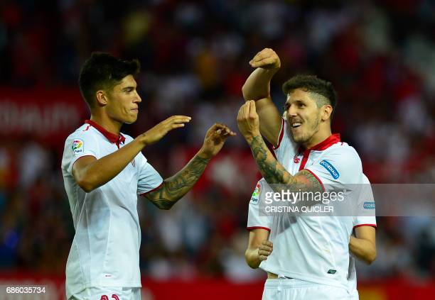 Sevilla's Montenegrin forward Stevan Jovetic celebrates after scoring a goal with Sevilla's Argentinian midfielder Joaquin Correa during the Spanish...