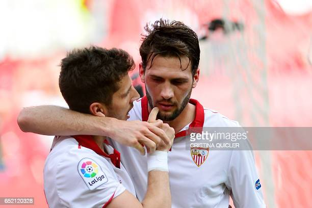 Sevilla's Montenegrin forward Stevan Jovetic celebrates with Sevilla's French forward Wissam Ben Yedder after scoring during the Spanish league...