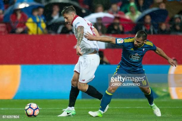 Sevilla's Montenegrin forward Stevan Jovetic vies with Celta Vigo's defender Jonny Castro during the Spanish league football match Sevilla FC vs RC...