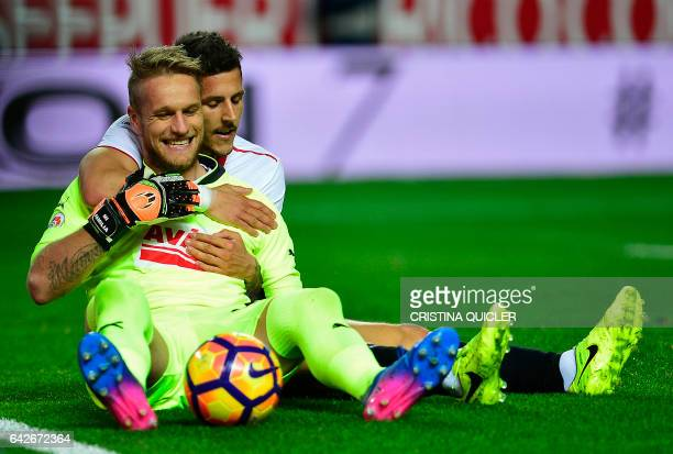 Sevilla's Montenegrin forward Stevan Jovetic vies with Eibar's goalkeeper Yoel Rodriguez during the Spanish league football match Sevilla FC vs SD...