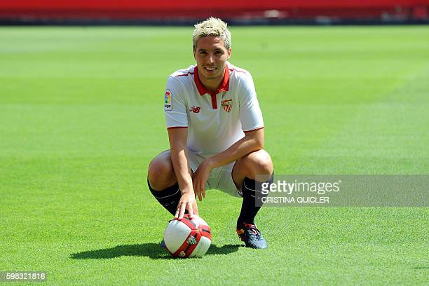 TOPSHOT Sevilla's new French player Samir Nasri poses on the pitch during his official presentation at the Ramon Sanchez Pizjuan stadium in Sevilla...