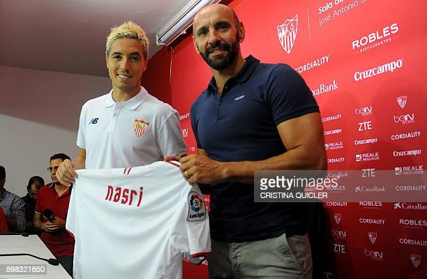 Sevilla's new French player Samir Nasri poses with Sevilla's sports director Monchi during his official presentation at the Ramon Sanchez Pizjuan...