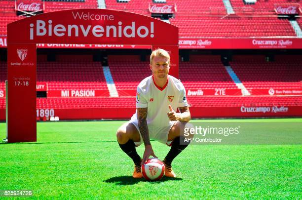 Sevilla's new player Danish defender Simon Kjaer thumbs up as he poses during his official presentation at the Sanchez Pizjuam stadium in Sevilla on...
