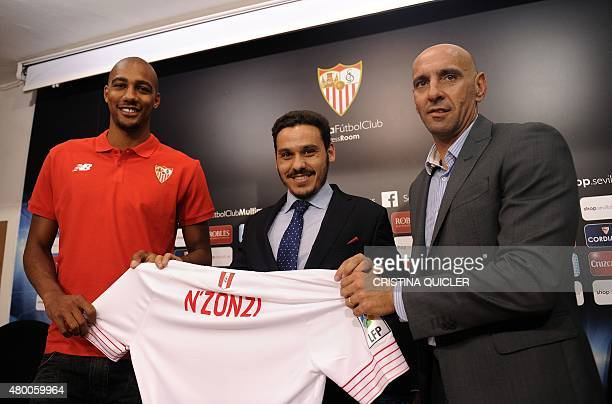 Sevilla's new player French midfielder Steven Nzonzi Sevilla's vicepresident Jose Maria del Nido Carrasco and Sevilla's director Monchi hold Nzonzi's...