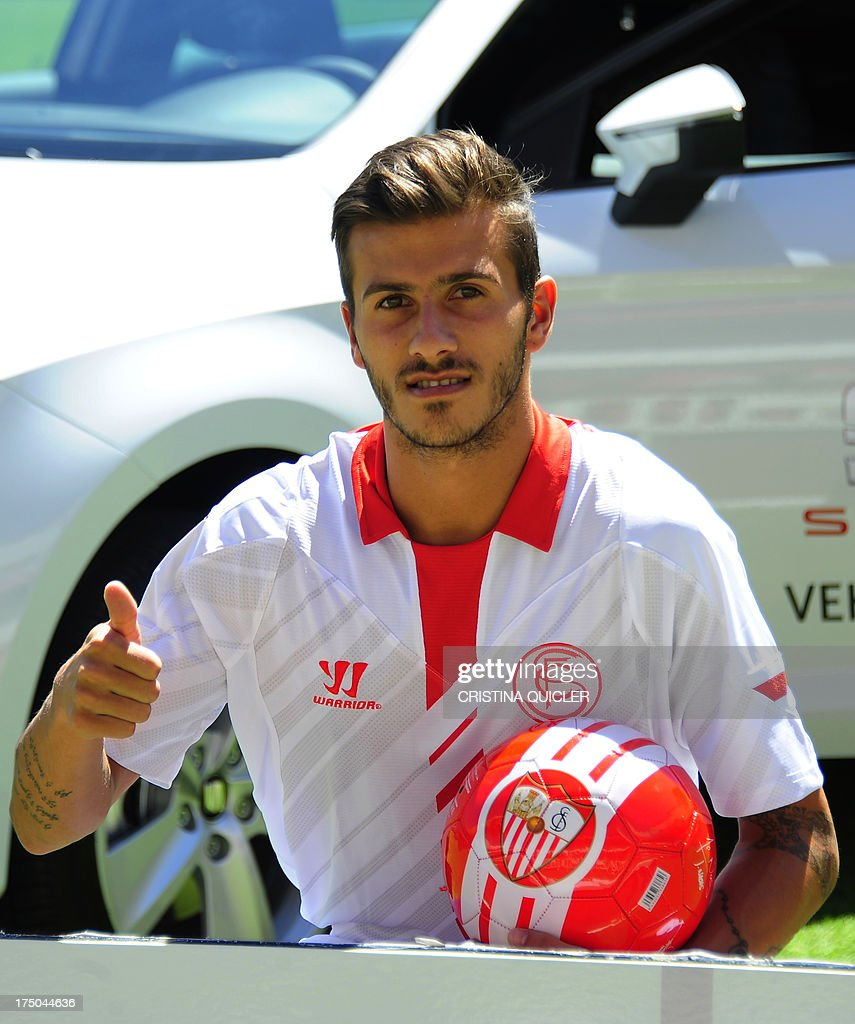 Sevilla's new Portuguese defender Diogo Figueiras gives the thumbs up as he poses during his presentation in Sevilla on July 30, 2013.
