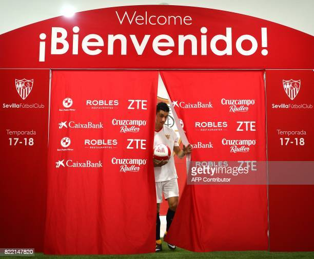 Sevilla's new signing Frenchman Sebastien Corchia arrives with a ball during his official presentation at the Sanchez Pizjuan Stadium in Seville on...