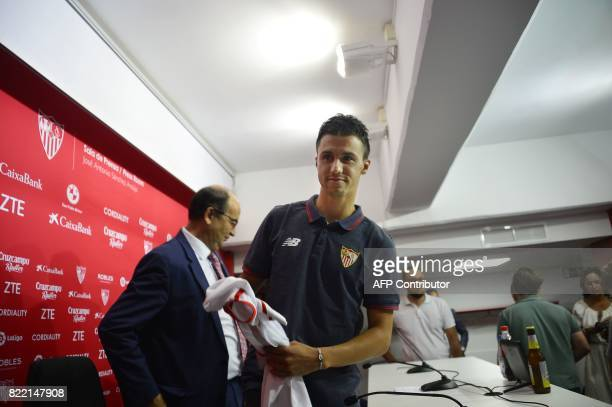 Sevilla's new signing Frenchman Sebastien Corchia holds a jersey during his official presentation at the Sanchez Pizjuan Stadium in Seville on 25...