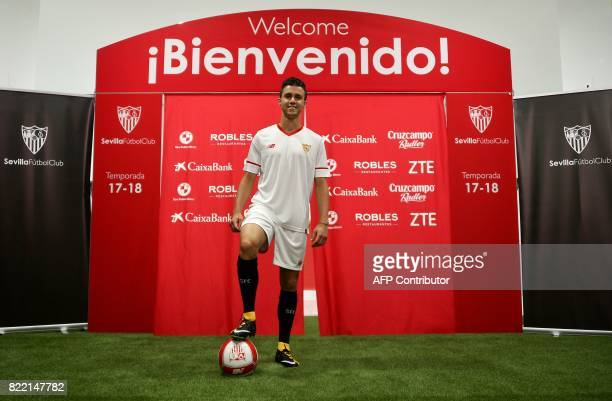 Sevilla's new signing Frenchman Sebastien Corchia poses with a ball during his official presentation at the Sanchez Pizjuan Stadium in Seville on 25...
