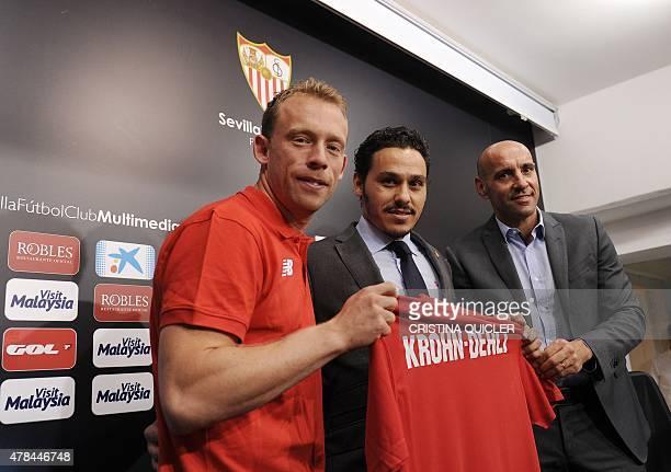 Sevilla's new signing international Danish midfielder Michael KrohnDehli poses with Sevilla's vicepresident Jose Maria del Nido Carrasco and Spanish...