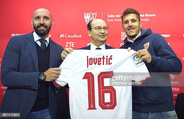 Sevilla's new signing Montenegrin Stevan Jovetic poses with the Sevilla official tshirt with President Pepe Castro and the Sports director Monchi...