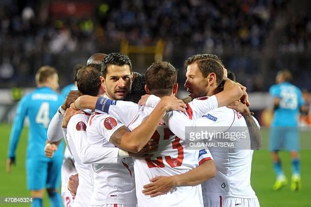 Sevilla's players celebrate after scoring a goal during the UEFA Europa League quarterfinal second leg football match Zenit Saint Petersburg vs...