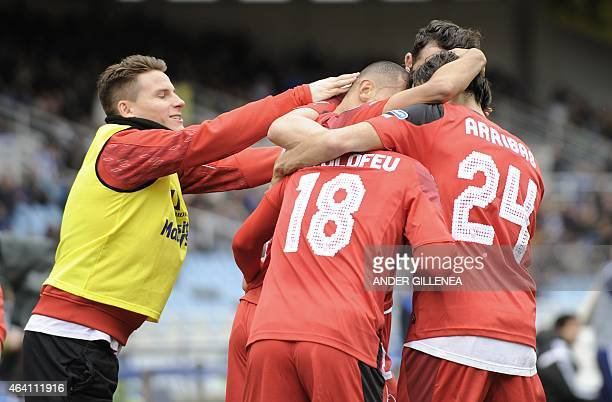 Sevilla's players celebrate after Sevilla's French defender Timothee Kolodziejczaks scored during the Spanish league football match Real Sociedad de...