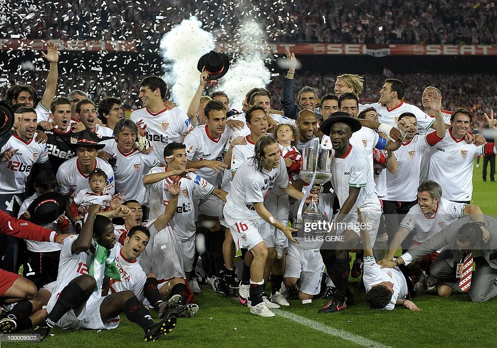 Sevilla's players celebrate after winning the King�s Cup final match against Atletico Madrid at the Camp Nou stadium in Barcelona on May 19, 2010. Sevilla won 2-0.
