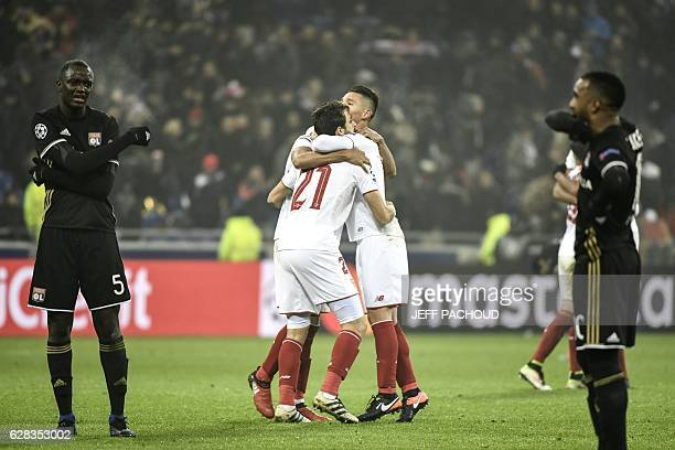 TOPSHOT Sevilla's players celebrate as Lyon's French forward Alexandre Lacazette and Lyon's defender Mouctar Diakhaby react at the end of the UEFA...