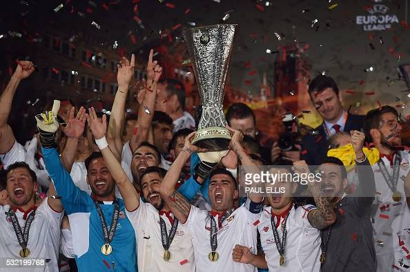 TOPSHOT Sevilla's players celebrate with the trophy after winning the UEFA Europa League final football match between Liverpool FC and Sevilla FC at...