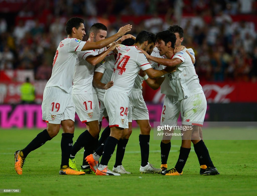 Sevilla's players celebrates after scoring during the Spanish league football match Sevilla FC vs Espanyol at the Ramon Sánchez-Pizjuan in Sevilla on August 19, 2017. QUICLER