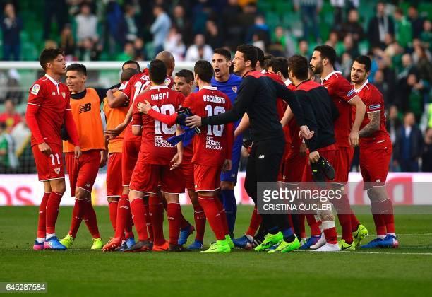 Sevilla's players celebrates after winning the Spanish league football match Real Betis vs Sevilla FC at the Benito Villamarin stadium in Sevilla on...