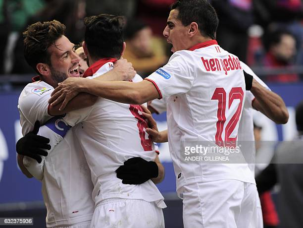 Sevilla's playres celebrate after their team's scoring the third goal during the Spanish league football match CA Osasuna vs Sevilla FC at El Sadar...