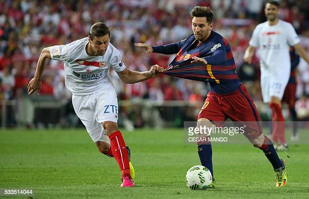 Sevilla's Polish midfielder Grzegorz Krychowiak vies with Barcelona's Argentinian forward Lionel Messi during the Spanish 'Copa del Rey' final match...