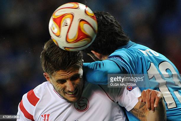 Sevilla's Portuguese midfielder Daniel Carrico vies for the ball with Zenit's Portuguese defender Luis Neto during the UEFA Europa League...