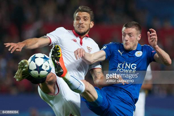 Sevilla's Portuguese midfielder Daniel Carrico vies with Leicester City's forward Jamie Vardy during the UEFA Champions League round of 16 second leg...