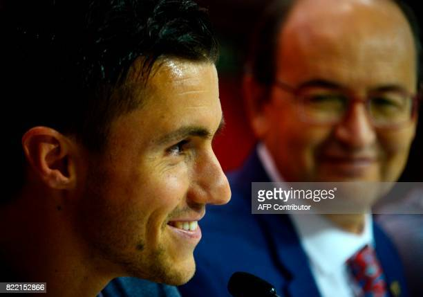 Sevilla's president Jose Castro looks towards Sevilla's new signing Frenchman Sebastien Corchia looks on during his official presentation at the...