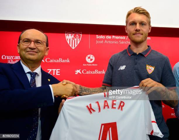 Sevilla's president Jose Castro poses with Sevilla's new player Danish defender Simon Kjaer during his official presentation at the Sanchez Pizjuam...