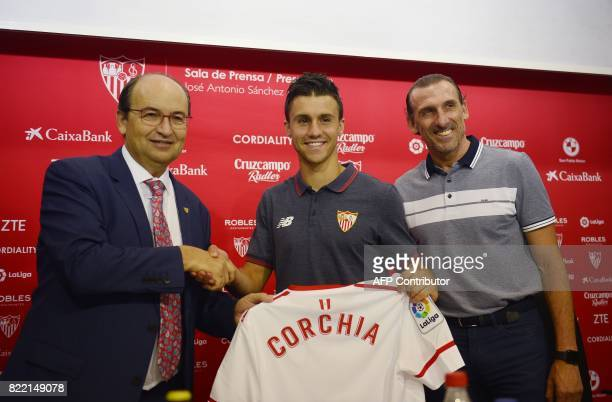 Sevilla's president Jose Castro poses with Sevilla's new signing Frenchman Sebastien Corchia and Sevilla's sports director Oscar Arias during...