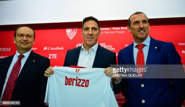Sevilla's president Jose Castro Sevilla's new coach Argentinian Eduardo Berizzo and Sevilla's sports director Oscar Arias pose with a jersey...