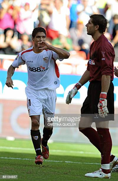 Sevilla's Renato celebrates after scoring against Athletico de Bilbao's goalkeeper Iraizoz during a Spanish league football match at the Sanchez...