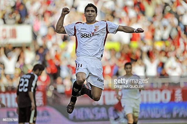 Sevilla's Renato Dirnei celebrates after scoring a goal against Real Madrid during their Spanish league football match at Sanchez Pizjuan stadium in...