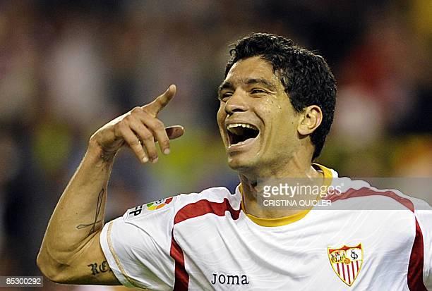 Sevilla's Renato Dirnei celebrates after scoring against Almeria during their Spanish league football match against Almeria at Sanchez Pizjuan...