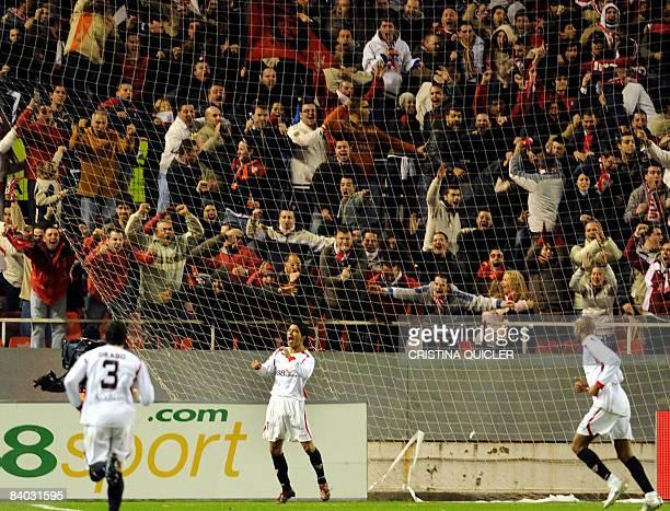 Sevilla's Renato Dirnei celebrates after scoring against Villarreal during their Spanish league football match at Sanchez Pizjuan stadium in Sevilla...