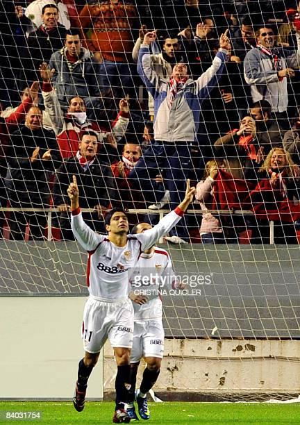 Sevilla's Renato Dirnei celebrates after scoring against Villarreal during their Spanish league football match at Sanchez Pizjuan stadium in Seville...