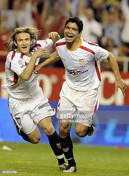 Sevilla's Renato Dirnei celebrates after scoring with Diego Capel against Almeria during their Spanish league football match against Almeria at...