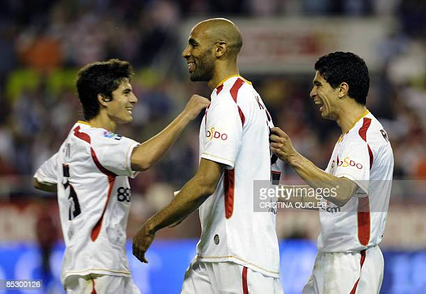 Sevilla's Renato Dirnei celebrates after scoring with Diego Perotti and Frédéric Kanouté against Almeria during their Spanish league football match...
