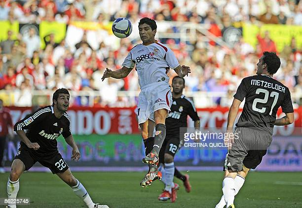 Sevilla's Renato Dirnei scores a goal against Real Madrid's Christoph Metzelder Marcelo Vieira and Miguel Torres during their Spanish league football...