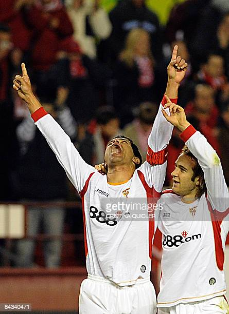 Sevilla's Renato Dirnei scores and celebrates with Diego Capel a goal against Numancia during their Spanish league football match at Sanchez Pizjuan...