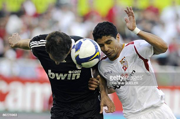 Sevilla's Renato Dirnei vies with Real Madrid's Christoph Metzelder during their Spanish league football match at Sanchez Pizjuan stadium in Seville...
