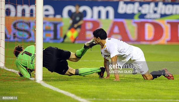 Sevilla's Renato is accidentally kicked in the mouth by Stuttgart's goalkeeper Jens Lehmann after scoring a goal during their UEFA Cup football match...