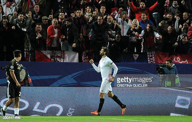 Sevilla's Spanish forward Fernando Llorente celebrates after scoring a goal during the UEFA Champions League Group D football match Sevilla FC vs...
