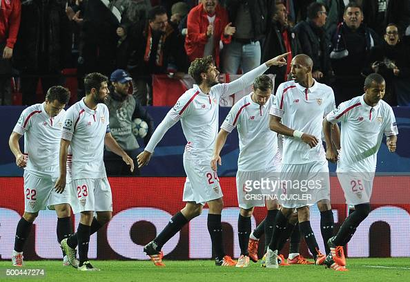 Sevilla's Spanish forward Fernando Llorente celebrates with teammates after scoring a goal during the UEFA Champions League Group D football match...