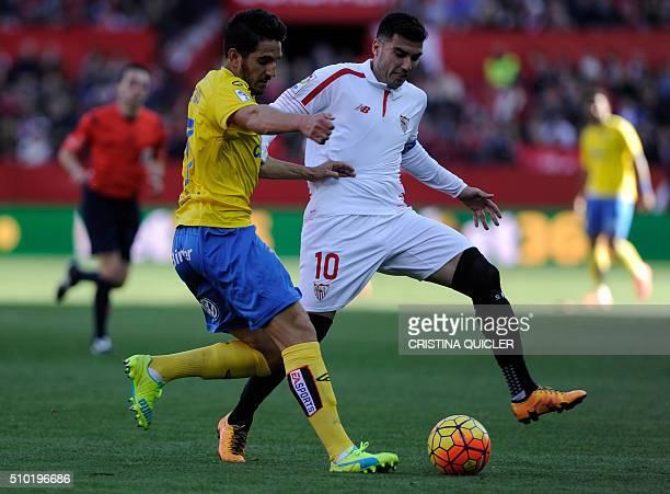 Sevilla's Spanish forward Jose Antonio Reyes vies with Las Palmas' defender Pedro Bigas Rigo during the Spanish league football match FC Sevilla vs...
