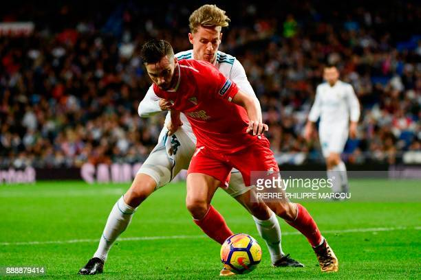 Sevilla's Spanish midfielder Pablo Sarabia challenges Real Madrid's Spanish miedfieder Marcos Llorente during the Spanish league football match...