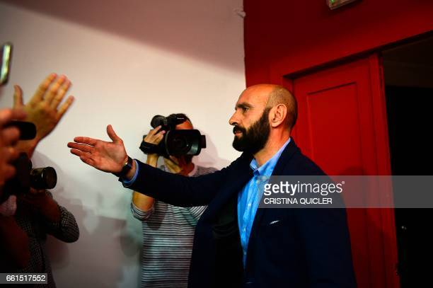Sevilla's Sports director Ramon Rodriguez Verdejo aka Monchi says farewell to journalists at the end of a press conference held to announce that he...