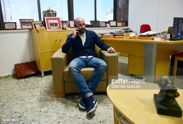 Sevilla's Sports director Ramon Rodriguez Verdejo 'Monchi' speaks on his mobile phone at his office in the Ramon Sanchez Pizjuan stadium in Sevilla...