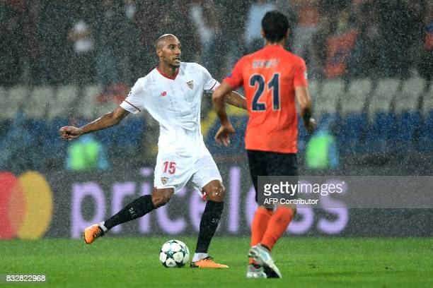 Sevilla's Steven N'Zonzi vies for the ball with Basaksehir's Mahmut Tekdemir during the UEFA Champions League playoff first leg football match...