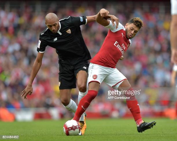 Sevilla's Steven N'Zonzi vies with Arsenal's English midfielder Alex OxladeChamberlain during the preseason friendly football match between Arsenal...